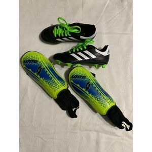 Boys Adidas soccer cleats with shin guards